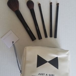 Natural hair makeup brush set and a makeup bag